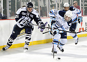 Nick Sorkin (UNH - 21),Joey Diamond (Maine - 39) - The University of Maine Black Bears defeated the University of New Hampshire Wildcats 5-4 in overtime on Saturday, January 7, 2012, at Fenway Park in Boston, Massachusetts.