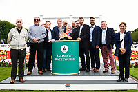 Connections of Move Over receive their trophy from Sponsors after winning The M J Church British EBF Novice Stakes (Plus 10) (Div 1), during Afternoon Racing at Salisbury Racecourse on 7th August 2017