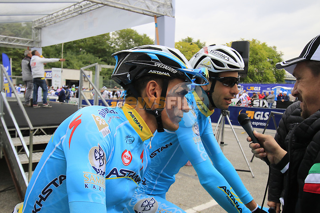 Paolo Tiralongo and Fabio Aru (ITA) Astana at sign on for the start of the 2015 96th Milan-Turin 186km race starting at San Giuliano Milanese, Italy. 1st October 2015.<br /> Picture: Eoin Clarke | Newsfile