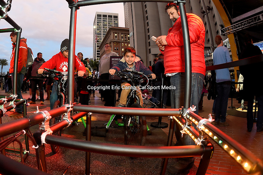 Wednesday, February 3, 2016: Spectators compete against each other pedaling electricity generating bicycles to light an LED display at Super Bowl City in San Francisco, California during the National Football League week long opening celebrations for Super Bowl 50 between the Carolina Panthers and the Denver Broncos . Eric Canha/CSM