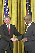 United States President George W. Bush shakes hands with US Secretary of Education Rod Paige after he made remarks to African-American leaders in the East Room of the White House in Washington, DC on March 29, 2001. <br /> Credit: Ron Sachs / CNP