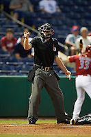 Umpire Matt Winter makes a call during the second game of a doubleheader between the Jupiter Hammerheads and Clearwater Threshers on July 25, 2015 at Bright House Field in Clearwater, Florida.  Clearwater defeated Jupiter 2-1.  (Mike Janes/Four Seam Images)