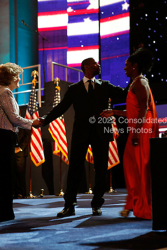 Washington, DC - January 20, 2009 -- United States Denzel Washington and his wife Pauletta Pearson (R) attend the Neighborhood Inaugural Ball at the Washington Convention Center on January 20, 2009 in Washington, DC. Obama became the first African-American to be elected to the office of President in the history of the United States.  .Credit: Chip Somodevilla - Pool via CNP