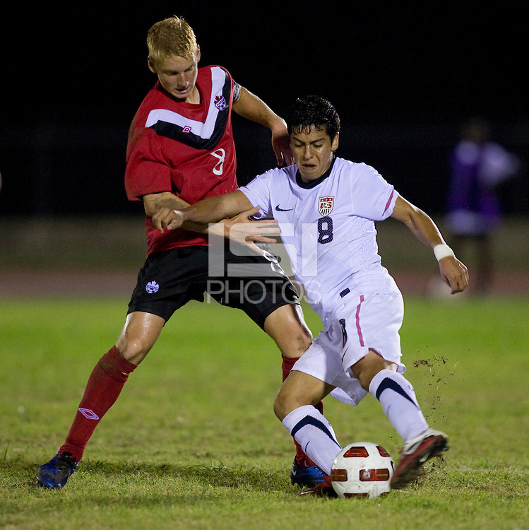 Esteban Rodriguez (8) of the United States fights for the ball with Bryce Alderson (8) of Canada during the finals of the CONCACAF Men's Under 17 Championship at Catherine Hall Stadium in Montego Bay, Jamaica. The United States defeated Canada, 3-0, in overtime