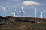 Infigen Energy wind turbines located near Bungendore, New South Wales, Australia, July 25, 2014. The Capital wind farm is a part of the Capital Renewable Energy Precinct. The wind farm commenced commercial operations in January 2010. It has a total installed capacity of 140.7 MW, net capacity factor of ~30%. It comprises 67 Suzlon S88 wind turbines with a rating of 2.1 MW. Electricity and Large-scael Generation Certificates (LGCs) generated are under a 20-year Power Purchase Agreement to the Sydney Desalination Plant. Photographer: Mark Graham/Bloomberg