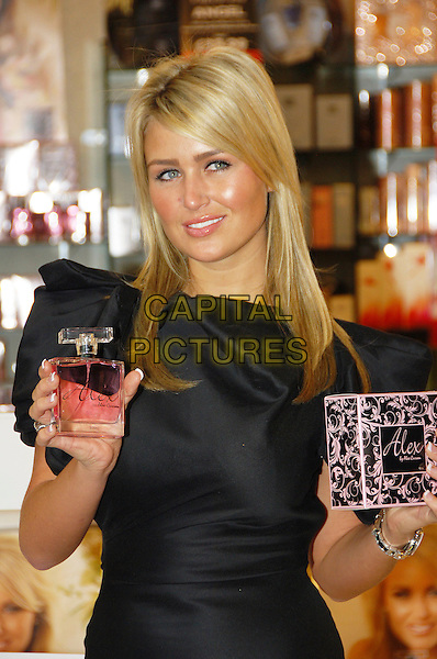 ALEX CURRAN.OK! Perfume - press launch, The Perfume Shop, London, England..November 1st, 2007.fragrance half length black satin dress bottle.CAP/CAS.©Bob Cass/Capital Pictures.