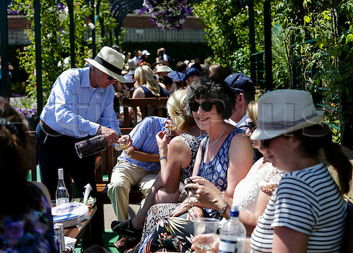 10.07.2015.  Wimbledon, England. The Wimbledon Tennis Championships. General view of fans taking a refreshment break and enjoying the atmosphere around the grounds