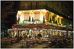 Brasserie Le Champ de Mars, located near the Champ de Mars and the Eiffel Tower, viewed at night in full Christmas decor