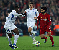 5th November 2019; Anfield, Liverpool, Merseyside, England; UEFA Champions League Football, Liverpool versus Genk; Mohammed Salah of Liverpool runs with the ball as Carlos Cuesta of KRC Genk covers him - Editorial Use