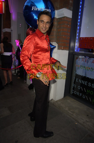 CHICO SLIMANI .First News - launch party at Fire & Stone, Covent Garden, London, UK..May 4th, 2006.Ref: CAN.full length red satin shirt.www.capitalpictures.com.sales@capitalpictures.com.©Capital Pictures