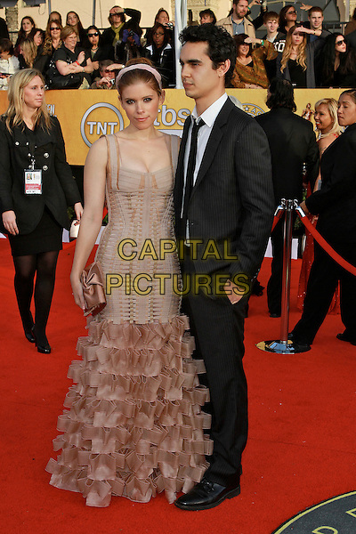 KATE MARA & MAX MINGHELLA.17th Annual Screen Actors Guild Awards held at The Shrine Auditorium, Los Angeles, California, USA..January 30th, 2011.SAG arrivals full length beige pink ruffle fishtail dress sleeveless hairband clutch bag black suit white shirt couple.CAP/ADM/KB.©Kevan Brooks/AdMedia/Capital Pictures.