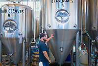 NWA Democrat-Gazette/CHARLIE KAIJO Bike Rack Brewing manager Kyle Grover stands next to a fermenter, Thursday, August 8, 2019 at the Bike Rack Brewing in Bentonville.<br /> <br /> Bike Rack Brewing is distributing into Little Rock now.