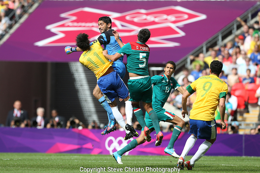 Brazil's Neymar da Silva Santos Junior during is taken out of play by Mexico's captain and goalkeeper Jose Corona and Darvin Chavez in the gold medal match at Wembley Stadium, London, UK. Saturday 11th August 2012. (Photo: Steve Christo)