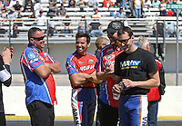 Mar. 16, 2013; Gainesville, FL, USA; NHRA Arana pro stock motorcycle riders Hector Arana Jr and brother Adam Arana with crew members during qualifying for the Gatornationals at Auto-Plus Raceway at Gainesville. Mandatory Credit: Mark J. Rebilas-