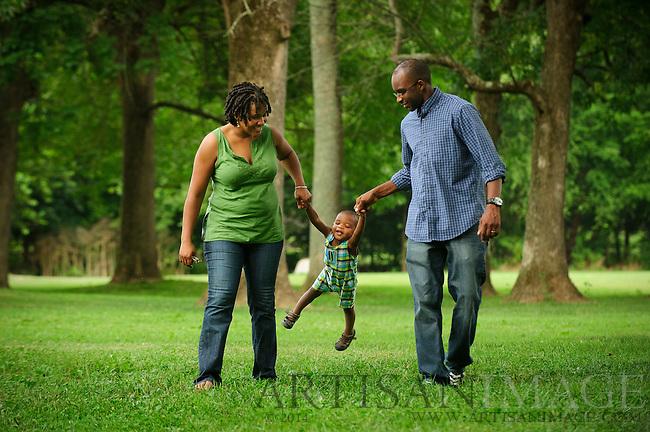 Joshua Goins enjoys an afternoon at the park with his parents Lanita and James Goins. (Chris English/Artisan Image)