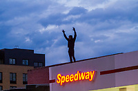 NEW YORK, NEW YORK - MAY 30: A protester stands on the roof of a gas station during the protest in response to the police officer who killed George Floyd in Brooklyn on May 30, 2020 in New York. The protests spread across the country in at least 30 cities in the United States. United States For the death of unarmed black man George Floyd at the hands of a police officer, this is the latest death in a series of police deaths of black Americans (Photo by Pablo Monsalve / VIEWpress via Getty Images)