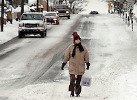 An unidentified woman, who declined to give her name, walks on a  snow covered street after a winter snow storm December 9, 2005 in Doylestown, Pennsylvania. The Philadelphia region was hit with alomst 8 inches of snow, closing schools and some businesses. Photo by William Thomas Cain / photodx.com