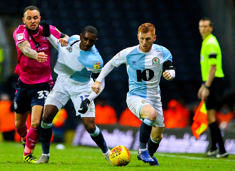 Blackburn Rovers' Harrison Reed steals the ball as Amari'i Bell tussles with Queens Park Rangers' Jake Bidwell<br /> <br /> Photographer Alex Dodd/CameraSport<br /> <br /> The EFL Sky Bet Championship - Blackburn Rovers v Queens Park Rangers - Saturday 3rd November 2018 - Ewood Park - Blackburn<br /> <br /> World Copyright © 2018 CameraSport. All rights reserved. 43 Linden Ave. Countesthorpe. Leicester. England. LE8 5PG - Tel: +44 (0) 116 277 4147 - admin@camerasport.com - www.camerasport.com