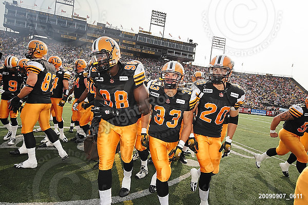 September 7, 2009; Hamilton, ON, CAN; Hamilton Tiger-Cats defensive end Montez Murphy (98) running back Andre Sadeghian (33) defensive back Dylan Barker (20). CFL football - the Labour Day Classic - Toronto Argonauts vs. Hamilton Tiger-Cats at Ivor Wynne Stadium. The Tiger-Cats defeated the Argos 34-15. Mandatory Credit: Ron Scheffler.