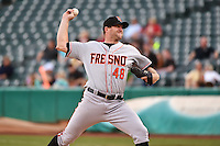 Mitch Lively (48) of the Fresno Grizzlies  delivers a pitch to the plate against the Salt Lake Bees at Smith's Ballpark on April 9, 2014 in Salt Lake City, Utah.  (Stephen Smith/Four Seam Images)