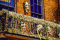 Mardi Gras decorations on a Bourbon Street balcony, French Quarter, New Orleans, Louisiana USA