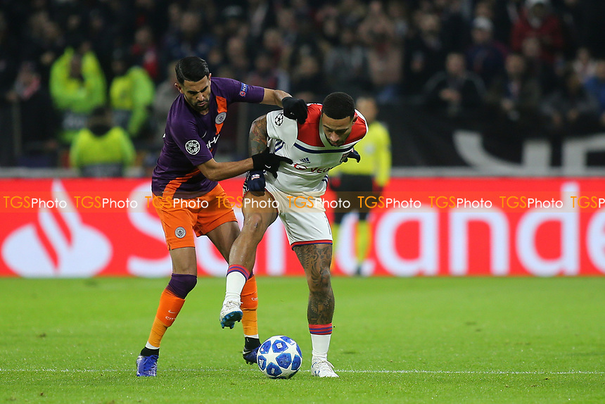 Riyad Mahrez of Manchester City tackles Lyon's Memphis Depay during Lyon vs Manchester City, UEFA Champions League Football at Groupama Stadium on 27th November 2018