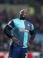 Adebayo Akinfenwa of Wycombe Wanderers reaction to Coventry City fans who hurl abuse at him during the match during the The Checkatrade Trophy - EFL Trophy Semi Final match between Coventry City and Wycombe Wanderers at the Ricoh Arena, Coventry, England on 7 February 2017. Photo by Andy Rowland.