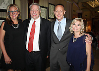 NWA Democrat-Gazette/CARIN SCHOPPMEYER Sara and Jim Widmer (from left) and Big Night co-chairman Jason and Michelle Nichol help support the Jones Center on Oct. 29.