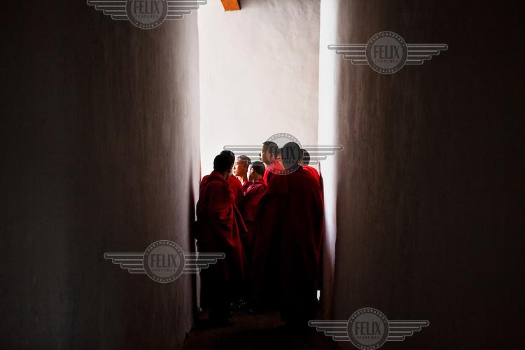Buddhist monks seen at the ancient Punakha Dzong (fortress) in Punakha, Bhutan.