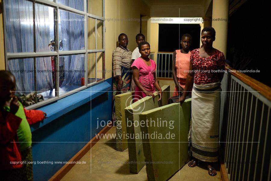 TANZANIA Mara, Tarime, village Masanga, region of the Kuria tribe who practise FGM Female Genital Mutilation, temporary rescue camp of the Diocese Musoma for girls which escaped from their villages to prevent FGM / TANSANIA Mara, Tarime, Dorf Masanga, in der Region lebt der Kuria Tribe, der FGM weibliche Genitalbeschneidung praktiziert, temporaerer Zufluchtsort fuer Maedchen, denen in ihrem Dorf Genitalverstuemmelung droht, in einer Schule der Dioezese Musoma, rechts DOROTHY ROBI MOTORA