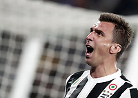 Football Soccer: UEFA Champions League Juventus vs Olympiacos Allianz Stadium. Turin, Italy, September 27, 2017. <br /> Juventus' Mario Mandzukic celebrates after scoring during the Uefa Champions League football soccer match between Juventus and Olympiacos at Allianz Stadium in Turin, September 27, 2017.<br /> UPDATE IMAGES PRESS/Isabella Bonotto