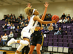 SIOUX FALLS, SD - DECEMBER 7: Gloria Mulumba #21 from the University of Sioux Falls scoops a shot against Concordia St. Paul during their game Friday night at the Stewart Center in Sioux Falls, SD. (Photo by Dave Eggen/Inertia)