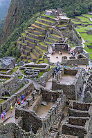 Peru, Machu Picchu.  Looking down on the Western Urban Sector, with the Intiwatana (Hitching Post of the Sun) and Agricultural Terraces in the Upper Half.