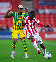 4th November 2019; Bet365 Stadium, Stoke, Staffordshire, England; English Championship Football, Stoke City versus West Bromwich Albion; Badou Ndiaye of Stoke City pushes into Grady Diangana of West Bromwich Albion - Strictly Editorial Use Only. No use with unauthorized audio, video, data, fixture lists, club/league logos or 'live' services. Online in-match use limited to 120 images, no video emulation. No use in betting, games or single club/league/player publications