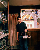TURKEY, Istanbul, portrait of teenage boy carrying coffee cups in the Grand Bazaar.