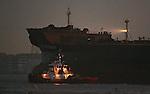 "Tug boat guide the super tanker ""Long Beach"" through the gate pass Alcatraz Island."