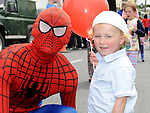 Ewan Curran pictured with Spiderman at the Clogherhead 10k run. Photo: Colin Bell/pressphotos.ie