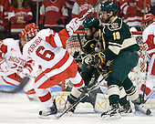 Joe Pereira (BU - 6), Matt White (Vermont - 19) - The visiting University of Vermont Catamounts tied the Boston University Terriers 3-3 in the opening game of their weekend series at Agganis Arena in Boston, Massachusetts, on Friday, February 25, 2011.