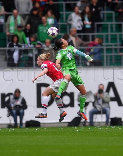 21.04.2013. Wolfsburg, Germany. Womens Champions League, Wolfsburg versus Arsenal, second leg.  l-r:  Kim LITTLE (FC Arsenal London) , Nadine KESSLER (VfL Wolfsburg)