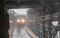 An elevated Flushing Line train arrives at the Queensboro Plaza station in New York during Winter Storm Jonas on Saturday, January 23, 2016. Due to blizzard conditions approaching the MTA announced they will be suspending all above ground subway service as of 4:00 PM. (© Richard B. Levine)
