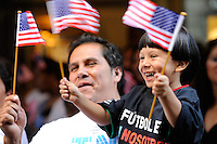 A family waves American flags as they await the arrival of members of the FIFA World Cup Inspection Delegation at the St. Regis Hotel in New York, NY, on September 06, 2010.