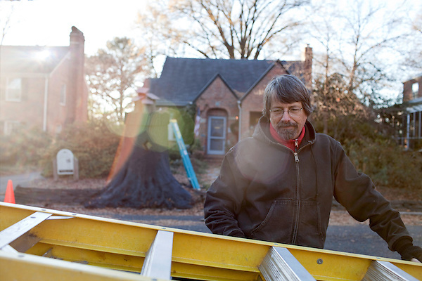 December 14, 2010. Durham, NC.. Frank Hyman packs up his equipment after working on a sculpture he is building in the front yard of Ellen Dagenhart that will also serve as a home for local birds.. Mr. Hyman, a former member of the Durham city council, now makes his living doing a variety of things, such as landscaping, woodworking, writing and art.