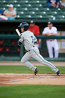 West Michigan Whitecaps right fielder Jacob Robson (7) follows through on a swing during a game against the Peoria Chiefs on May 8, 2017 at Dozer Park in Peoria, Illinois.  West Michigan defeated Peoria 7-2.  (Mike Janes/Four Seam Images)