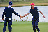 Daniel Berger (USA) congratulates Justin Thomas (USA) on sinking his long birdie putt on 14 during round 3 Four-Ball of the 2017 President's Cup, Liberty National Golf Club, Jersey City, New Jersey, USA. 9/30/2017.<br /> Picture: Golffile | Ken Murray<br /> <br /> All photo usage must carry mandatory copyright credit (&copy; Golffile | Ken Murray)
