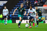 George Byers of Swansea City battles with Scott Sinclair of Preston North End during the Sky Bet Championship match between Preston North End and Swansea City at the Deepdale Stadium in Preston, England, UK. Saturday 01 February 2020