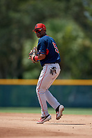 GCL Red Sox second baseman Ceddanne Rafaela (5) throws to first base during a Gulf Coast League game against the GCL Pirates on August 1, 2019 at Pirate City in Bradenton, Florida.  GCL Red Sox defeated the GCL Pirates 11-3.  (Mike Janes/Four Seam Images)