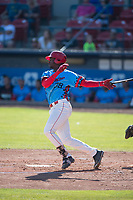 Spokane Indians designated hitter Sherten Apostel (38) follows through on his swing during a Northwest League game against the Vancouver Canadians at Avista Stadium on September 2, 2018 in Spokane, Washington. The Spokane Indians defeated the Vancouver Canadians by a score of 3-1. (Zachary Lucy/Four Seam Images)