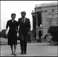 BNPS.co.uk (01202 558833)<br /> Pic: Bonhams/BNPS<br /> <br /> The young Senator and Mrs Kennedy go for a stroll on Capitol Hill.<br /> <br /> Fascinating photographs of the Kennedys during their first year of marriage have emerged for auction.<br /> <br /> The intimate snaps of the future US president and his wife Jackie were taken by renowned photographer Orlando Suero who spent five days with the couple at their Georgetown home in May 1954.<br /> <br /> At the time, Kennedy was a young senator from Massachusetts establishing himself as one to watch on the US political scene.<br /> <br /> The collection's owner, Max Lowenherz, donated the bulk of the photographs and negatives to the Peabody Institute of Johns Hopkins University in Maryland, USA.<br /> <br /> He has now decided to put 31 of them up for auction and they are tipped to sell for &pound;4,900 ($6,000).