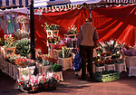 A3A8Y7 Customer browsing at a flower market stall Ipswich Suffolk England. Image shot 2006. Exact date unknown.