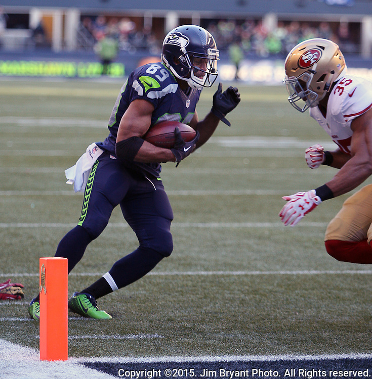 Seattle Seahawks wide receiver Doug Baldwin (89) tries to get away San Francisco 49ers defensive back  Eric Reid (35) at CenturyLink Field in Seattle, Washington on November 22, 2015.  The Seahawks beat the 49ers 29-13.   ©2015. Jim Bryant Photo. All RIghts Reserved.